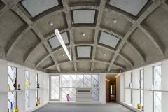 Na míru vyvinuté skleněné tvarovky vycházejí z formátu a kladení břidlicových desek užívaných na štítech a střechách v regionu